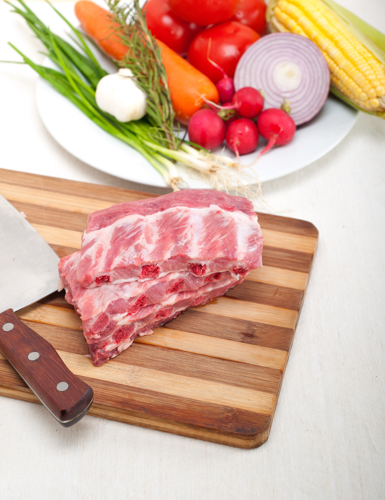 kozzi-4435259-chopping_fresh_pork_ribs_a