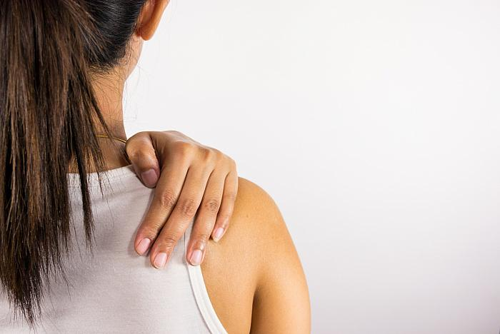 young woman with joint pain in her shoulder - arthritis?