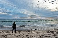 kozzi-7254809-Angler at the beach california-883x588